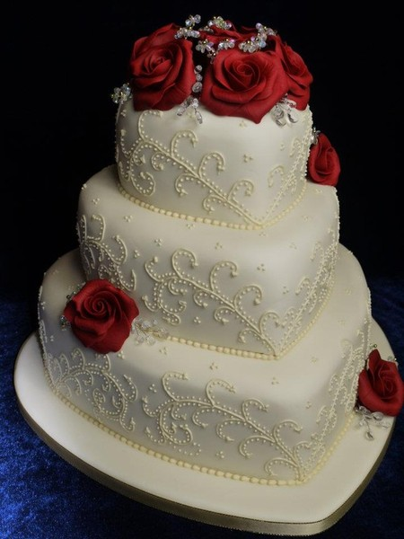 Ivory 3 tier heart shaped with ruby roses and ivory piping design ...
