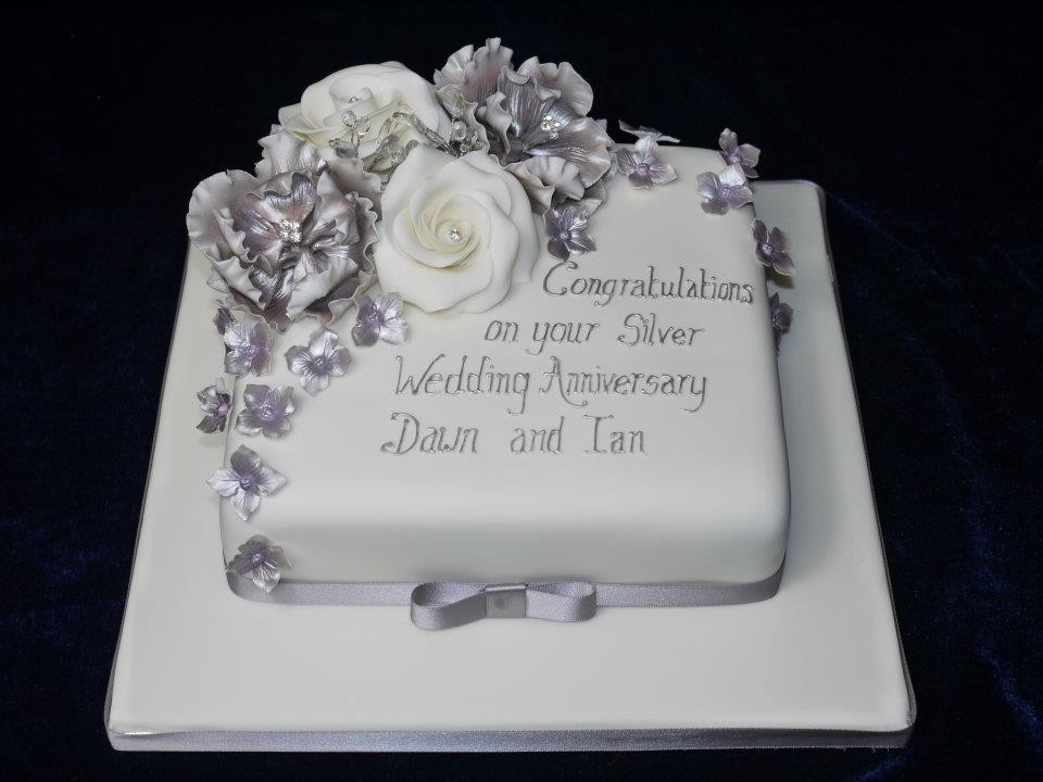 Silver anniversary cake with white and silver roses with silver ...